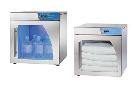 Fluid and blanket warming cabinets