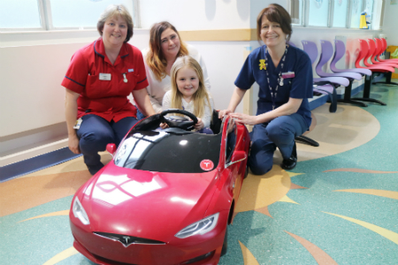 Children's unit goes electric as tiny Tesla drives into Poole Hospital